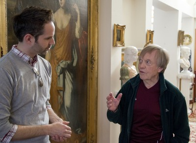 The collector, Torleif Tandstad, speaks with University Center for the Arts Creative Director Mike Solo, in his home as works of art are packed for museum delivery